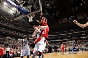 TMac dunking on Shawn Bradley courtesy hiphopwire.com